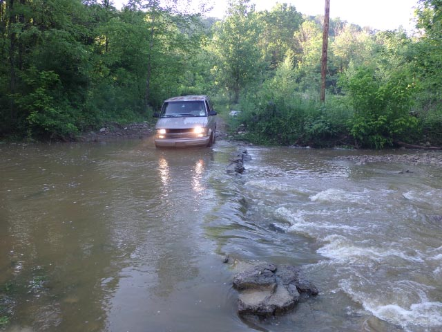 Van & flooded creek crossing